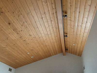 https://supremeceilings.co.za/wp-content/uploads/2021/02/knotty-pine-ceiling.jpg
